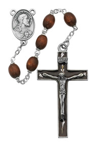 "6x8mm Sterling Silver brown wood rosary with a Sacred Heart Centerpiece. Sterling Silver brown wood bead rosary is 23"" in length."