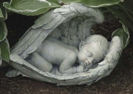 "Sleeping Baby In  Wings Figure. 7""H 14.25""W 7.5""D. Resin/ Stone Mix"