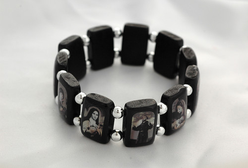 """Popular Brazilian Wood Stretch Bracelet. Portrays black and white images of popular Saints and visions of Our Lady. 3/4"""" Black Wooden Rectangular Shape separated by Beads."""