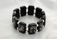 "Popular Brazilian Wood Stretch Bracelet. Portrays black and white images of popular Saints and visions of Our Lady. 3/4"" Black Wooden Rectangular Shape separated by Beads."