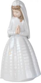 """This 9.5""""H Nao Girl Praying figurine is a popular favorite for First Holy Communion gifts. The girl is dressed in a beautiful white dress with white vail. Her hands are in the classic praying position and she has Rosary Beads. A great gift for your granddaughter's special religious event. Handcrafted of fine porcelain.Hand-crafted down to the finest detail, this fine collectible quickly becomes a treasured keepsake. Gift Boxed. Year Issued 1992"""