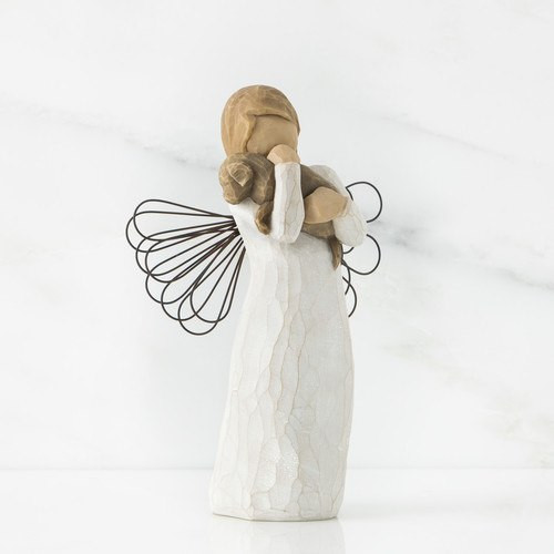 """""""For those who share the spirit of friendship.""""  Angel resin figurine holding and loving a puppy. 5-inch height."""
