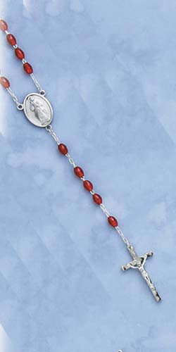 "Divine Mercy Deluxe Chaplet with Oval Red Beads. Packaged with a Divine Mercy ""Jesus I trust in you"" holy card with instructions on how to say the chaplet on reverse side.  (Overall 4"" x 2.5"")"