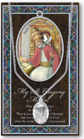 "Patron Saint of Teachers and England. 3"" X 5"" vinyl folder with removable oxidized medal.  1.125"" Genuine Pewter Saint Medal on a Stainless Steel Chain. Silver Embossed Pamphlet with Patron Saint Information and Prayer Included. Biography/History of the Saint and gives the Patron's attributes, Feast Day and Appropriate Prayer. (3.25""x 5.5"")"