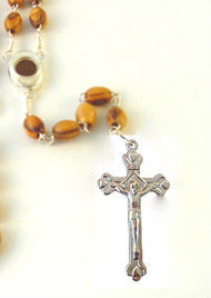 "Olive Wood Oval Rosary (8mm).Mounted on a silver plated chain with centerpiece containing Earth from Bethlehem where Jesus was born. Rosary is about 21"" inches long.  This rosary is hand made in Bethlehem, the Holy Land."