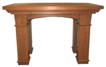 """The communion table is crafted using red oak and red oak veneer. Altar with boat shaped layered top. Dimensions: 40"""" height, 60"""" width, 42"""" depth"""