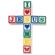 """Jesus Loves Me spelled out in primary color building blocks making a cross for display in bedroom or nursery. 8.5"""" x 6"""", white background; stone resin."""