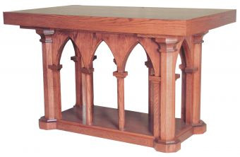 """The 535, 536, 537 & 538 series altars offer elegant woodworking along with a refined design. A series of 8 pillars support a solid wood surface. Made from red oak, this handmade alter will fit in beautifully with existing furniture and can be used for services or for decor. Few altars compare. Choose from a variety of sizes and wood stains.  Dimensions: (#535)  39"""" height, 60"""" width, 36"""" depth (#536)  39"""" height, 72"""" width, 36"""" depth (#537)  39"""" height, 84"""" width, 36"""" depth (#538)  39"""" height, 48"""" width, 48"""" depth"""