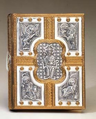 "Book of Gospels cover for use during the Liturgy of the Word.  Christ the Pantocrator is depicted in rich detail and surrounded by the symbols that traditionally represent the Four Evangelists.  The book cover comes from the artisans of Molina of Spain and is available in your choice of a brass, silver plate, gold plate, or two-tone finish.  When you place your order please include the precise dimensions of your Book of the Gospels. Minimum Size: 13H x 8 5/8""W x 1 1/4""Spine  Maximum Size: 4 3/16""H x 9 1/4""W x 1 9/16"" Spine The size of your book should be within the range of the dimensions. A larger book cover may be custom-produced at an additional cost, but a smaller cover may not.  A clasp is available at an additional cost."