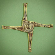 """St. Brigid cross ornament crafted of resin with the look of straw. Dangles from a gold cord hanger. Includes gift card featureing St. Brigid's Prayer. 3.25"""" x 3.25""""; gift boxed. St. Brigid is the patroness of Ireland, founded its first women's religious community. A cross made of rushes is her special emblem and is thought to ward away evil from the house that displays it"""