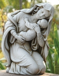 Statue of kneeling Madonna holding a baby.