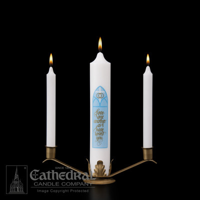 """This distinctive Unity Candle ensemble executed in soft tones projects the deep significance of the matrimony ceremony.  The ensemble includes center candle (3""""W)  and two side candles (2"""" x 12""""). Comes with a  gold finish stand as pictured."""