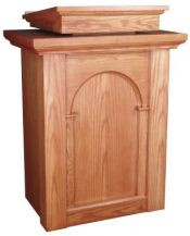 "Pulpit with two inside shelves  Book rest: 24"" width, 24"" depth  Dimensions: 46"" height, 34"" width, 24"" diameter  Brass lamps and symbols are available at an additional cost"