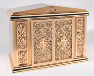 Overall Dimensisons: Height 22″, Width 28.3/8″, Depth 15.5″.  Door Opening: Height 14.50″, Width 14.50″. Tabernacle is made of bronze, bas relief sculpted decoration of satin and high polish bronze finish.  Other finishing options available upon request.  Interior is lined with white silk and aromatic cedar.  Independent action doors, vault locks and a durable oven baked finish.