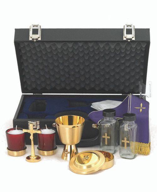 "Chalice Ht. 4"". 6 oz. Host box cap. 60. Cross Ht. 3 ¾"". Cruets 4 oz. Candles 2"". Case w/lock 14 ½"" x 9 ½"" x 4 5/8""."