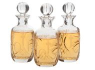 "Chrismal Set of Lead Crystal Bottles with 10 ounce capacity each, Height: 7"". Bottles are etched with OI, OS,  & SC. Note:  All glass may have irregularities."