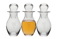 "Chrismal Set - Bottles are etched with OI, OS, & SC. Bottles have a  48 ounce capacity each, with a height of 11 3/4"". Note: all glass may have slight irregularities."