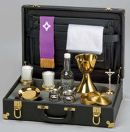"Traveling Mass Kit - 7 3/4"" x 13"" x 5"". High quality case with portfolio for linens. Includes the following items nested in poly-foam: 6"" Chalice and Paten metal all gold plated; 1 pair stainless steal cruets; 1 pair votive glass candlesticks; 1 16 oz. wine decanter; 1 metal host box; 1 standing crucifix; Chalices are all metal construction, all gold plated. Includeds priest's stole and altar linen. The chalice cups are silver plated before they are gold plated for durable finish."