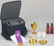 "Traveling Mass Kit with Soft Case - Soft side case 11 1/2"" x 9"" x 6"" with die-cut superfoam inside. Includes 4 1/2"" tall 24 K gold plated chalice, one combination paten/host (paten serves as lid for host box), a pair of votive glass candlesticks, one standing cruxifix, one each water and wine bottle. Includes priest's stole and altar linen."