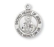 "13/16"" Sterling Silver Scapular medal showing the Sacred Heart of Jesus on the round shaped front and Our Lady of Mount Carmel on the reverse side. Sacred Heart of Jesus Medal comes with a genuine rhodium 18"" chain in a deluxe velour gift box."