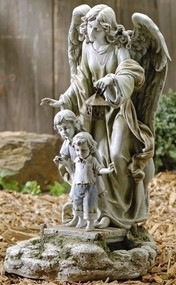 Garden statue of guardian angel standing behind two children holding a solar powered lantern.