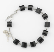 10mm Square Faceted Swarovski Jet Black Beads rosary bracelet.10mm Square Faceted Swarovski Crystal Beads rosary bracelet. Bracelet comes with Sterling Silver Miraculous Medal and Crucifix. Bracelet is available with sterling silver links or rhodium plated brass links. Comes in a deluxe velour gift box. Made in the USA