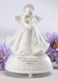 """5"""" First Holy Communion Musical Angel is made of porcelain. Message says """"First Holy Communion - I am the bread of life..."""". Tune plays the Lord's Prayer. Measurements: 5"""" height x 3.5"""" diameter. Gift Boxed."""