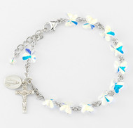 8mm Swararovski crystal butterfly shaped beads rosary bracelet. Sterling Silver Miraculous Medal and Crucifix with sterling silver links and chain or rhodium plated brass links and chain. Comes in a deluxe velour gift box. Made in the USA.
