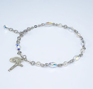 Deluxe Rosary Bracelet made with 6mm White Pearl and 6x9mm Aurora Borealis Oval Swarovski Crystal Beads. Choose from all sterling silver links, chains and exclusive designed Sterling Silver Miraculous Medal and Crucifix or Rhodium plated brass wire and chain with exclusive designed Sterling silver Miraculous Medal and crucifix. Presented in a deluxe velour metal gift box. Made in the USA