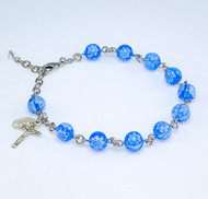 8mm Blue Flower Venetian Glass Beads with Miraculous Medal and Crucifix. Choose from: BX:  Solid Brass Links with Pewter Miraculous Medal and Crucifix; or BR: Rhodium Plated Brass links with Sterling Silver Miraculous Medal and Crucifix; or  B: All Sterling Silver Links,Miraculous Medal and Crucifix. Bracelets come with deluxe velour gift box. Made in the USA.