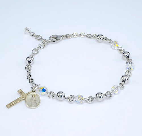 Aurora Swarovski Crystal Bracelet- 5mm Aurora Swarovski Crystal Beads and 5mm Round Sterling Silver Beads with Sterling Silver Miraculous Medal and Crucifix. Includes a Deluxe Velour Gift Box.Made in the USA.