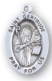 "Sterling silver  7/8"" oval medal with a portrait of St. Gertrude holding a Staff and a Book. She is the Patron of those in Pergatory. Comes on an 18"" genuine rhodium plated chain. Choice of sterling silver or gold filled medal. Comes in a deluxe velour gift box. Engraving option available."