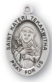 "Saint Kateri Tekakwitha Medal - Sterling silver 7/8"" oval medal with a portrayal of St. Kateri with a wooden cross and feathers. She is the patron saint of ecology, environment. Comes on an 18"" genuine rhodium plated chain  in a deluxe velour gift box. Engraving option available."