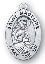 "Saint Madeline Medal - Patron Saint of the Catholic Church, 7/8"" oval medal with a portrayal of St. Madeline in a Nuns Habit.  Comes on an 18"" genuine rhodium plated chain in a deluxe velour gift box. Engraving option available."