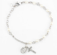 Rosary bracelet with 4mm Swarovski Imitation White Pearl beads. Rhodium plated brass findings. Silver oxidized miraculous medal and crucifix. Available colors: white, beige, blue, lavender, and pink. Comes with a deluxe velour gift box. Made in the USA.