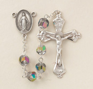 "Rosary with 7mm multi color metallic helix crystal beads. Sterling silver miraculous center and 2"" crucifix. Rhodium plated brass findings. Comes in a deluxe velour gift box. Made in the USA."