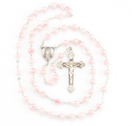 """Rosary made with 6mm freshwater pearls. Pink pearl rosary has a detailed sterling silver Miraculous Centerpiece with a 1-7/8"""" sterling silver Crucifix. Rhodium plated brass findings. Rosary comes with a deluxe velour gift box. Made in the USA."""