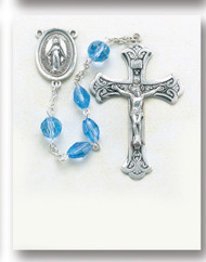 """Light Sapphire-5mm Light Sapphire Multi Faceted Oval Tin Cut Crystal Beads with 8mm Round Faceted """"Our Father"""" Beads. Sterling Silver Miraculous Center and 2-1/8"""" Sterling Silver Crucifix with Rhodium Plated Findings. Comes with a deluxe velour gift box. Made in the USA."""