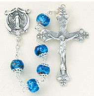 """8mm Blue or Pink Marble Double Capped Glass Beads. Solid brass findings, pins and chain with genuine rhodium plating to prevent tarnishing.  Exclusively designed Sterling Silver Miraculous Center and 2"""" Sterling Silver Crucifix. Deluxe Velour Gift Box Included.  Made in the USA!"""