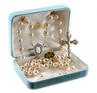 """8mm Light Rose Imitation Pearl Double Capped Beads. Rhodium platd brass wire and chain. Sterling Silver Miraculous Center and 1-7/8"""" Crucifix.  Comes in a deluxe gift box and is made in the USA."""