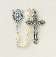 """Sterling Silver rosary made with 3x5mm oval faux pearl beads. Solid brass findings, pins and chain with genuine rhodium plating to prevent tarnishing. Exclusive designed sterling silver Miraculous Medal centerpiece and sterling silver 1-5/16""""crucifix. Comes with a deluxe velour gift box. Made in the USA."""