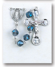 """8MM Metalllic Sapphire tin cut crystal beads. rosary is made of Rhodium plated brass wires and chains with a sterling silver Miraculous Medal and 2"""" Crucifix.  This tin cut sapphire bead rosary comes in a deluxe velvet box. Rosary is made in the USA."""