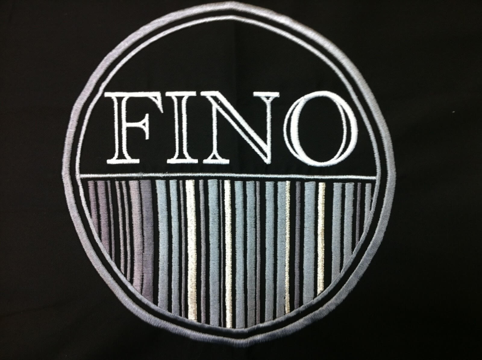 Fino men's salon loves Custom Salon Capes!
