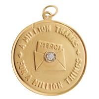 "Vintage ""Merci"" 14K Gold Charm"