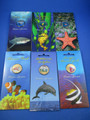 2006 - 2007 AUSTRALIAN $1 OCEAN SERIES COLOURED COINS ON CARDS. 6 COINS IN SET.