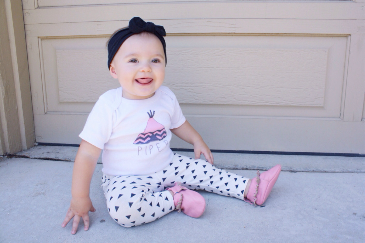 Piper modelling the short sleeve version of our Aztec Teepee Onesie