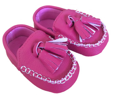 Raspberry pink baby loafers with tassels