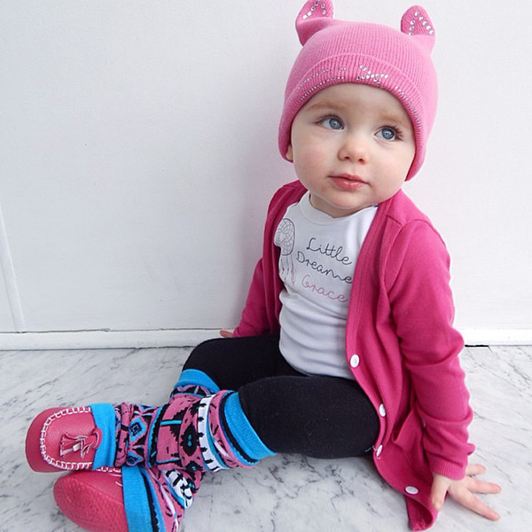 Grace in her Word On Baby raspberry pink loafers, pink and blue leg warmers, and personalised Little Dreamer onesie - @dollfacegrace @wordonbaby