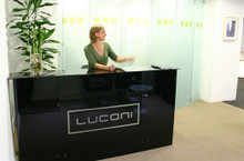 Product Code: GR 01. Reception desk made of a high quality glass finish. The black opaque glass provides high levels of privacy whilst providing an interesting and reflective vertical surface. Company name or logo can be added if required. Available in a range of sizes and finishes.