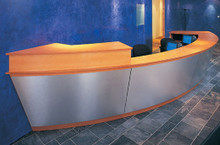 Product code: DR 01. Bespoke reception using combination of veneer wood and stainless steel vertical section. Specifically designed to fit within a defined space this reception enhances the space whereas a conventional unit may have been too deep or wide.